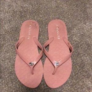 Pink coach flip flops